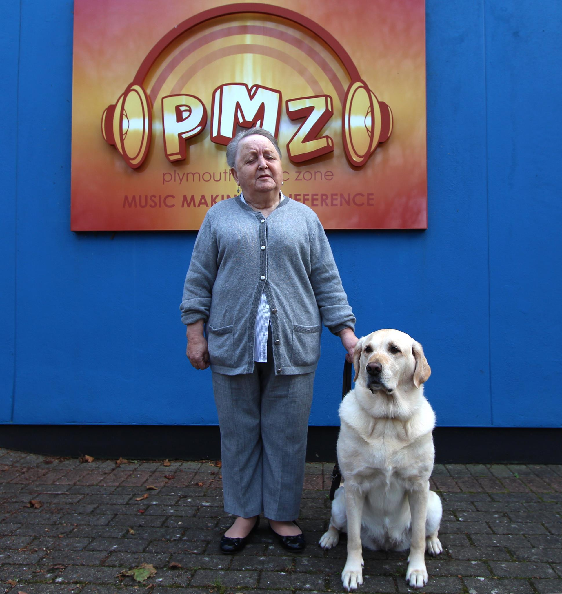 Pat & her guide-dog, Ziggy outside the PMZ building