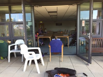 Delivering a music session through a doorway at a residential care home.