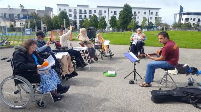 PMZ music leader Simon Hackworthy runs a residential home music session in a local park