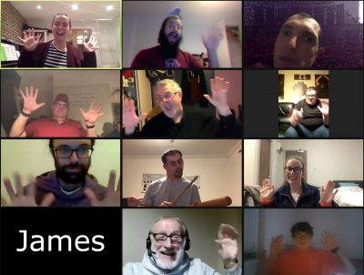 Zoom grid with everyone smiling and waving except for James, who is represented by a blank box