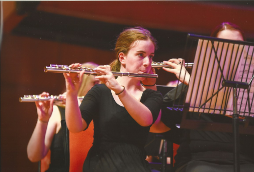 Katie performing with other musicians on stage