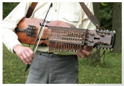 Person Playing Nyckelharpa