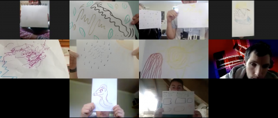 Each participant holding up their drawing